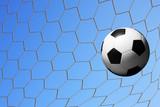 football in goal net.