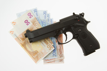 Semi-automatic gun and money isolated