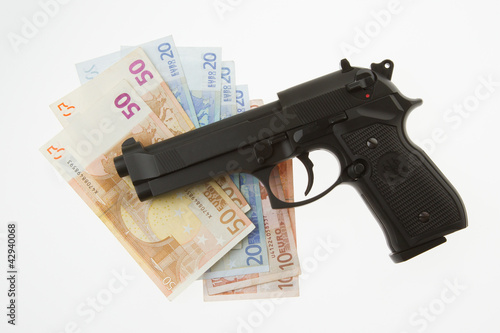 Fotobehang Jacht Semi-automatic gun and money isolated