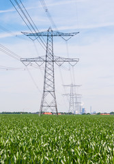 Row of power pylons and lines in a rural landscape