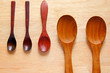 Collection of wooden kitchen spoons on wood background