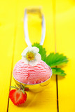 Metal scoop with strawberry icecream