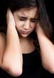 Portrait of a frightened hispanic  girl isolated on black