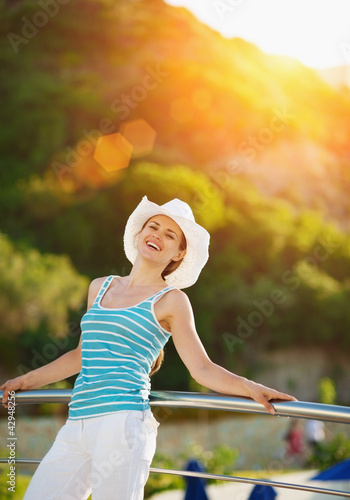 Portrait of happy woman enjoying vacation