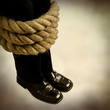 legs bound in rope