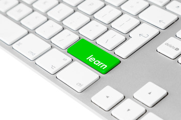 "Computer keyboard with green ""learn"" key. Internet e-learning."