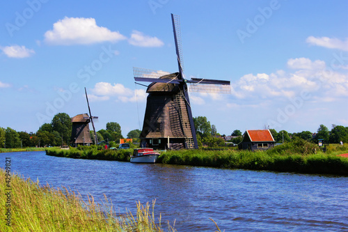 Dutch windmills along a canal near Alkmaar, Netherlands