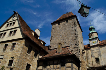 clock tower and medieval buildings in Rothenburg ob der Tauber