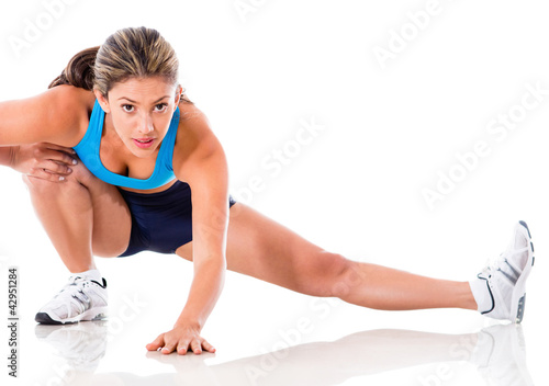 Female athlete stretching