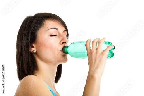 Young sportive woman drinking water