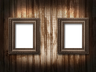 two picture frames on a wooden background grunge