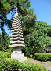 Japanese garden in the summer, stone traditional tower