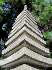 Japanese stone tower in a garden close up
