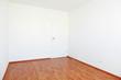 Empty room with white door