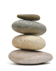 Balancing rocks isolated against white background