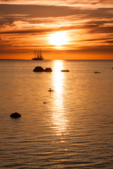 Sailing ship silhouette on sunset