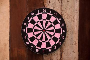 The Dartboard on wood background