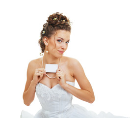 bride holds out card