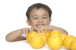 Funny child with many oranges isolated