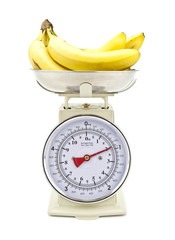 Old style kitchen scales with Bananas on white background Isolat