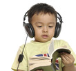 Nice child holding a book listening music