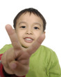Portrait of little boy showing victory hand sign