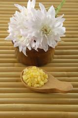 White Chrysanthemum with bath salt for aromatherapy on mat