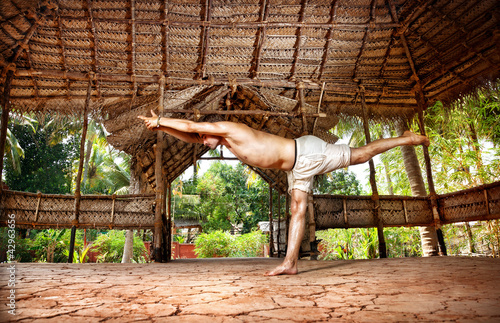Yoga warrior in Indian shala
