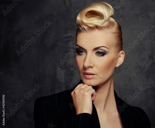 Fashionable woman with creative hairstyle