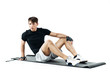 young handsome fitness man exercising on a mat