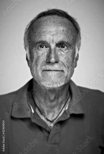 High contrast black and white portrait of senior man