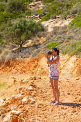 Female photographer in Greek scenery