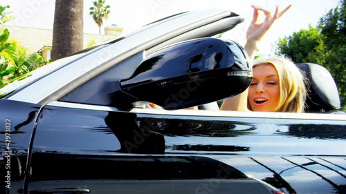 Beautiful Girls Waving Arms Driving Convertible Car