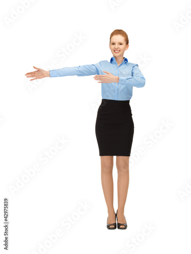 smiling stewardess showing direction