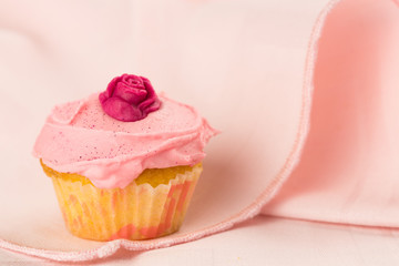 Pink cupcakes with red rose