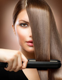 Fototapety Hairstyling.Hairdressing.Hair Straightening Irons.Straight Hair