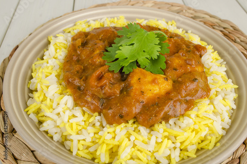 Chicken Bhuna & Bicolour Pilau Rice topped with Coriander