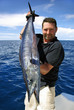 Lucky  fisherman holding a beautiful wahoo fish