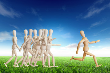 Wooden man run over the crowd for Human Resources concept