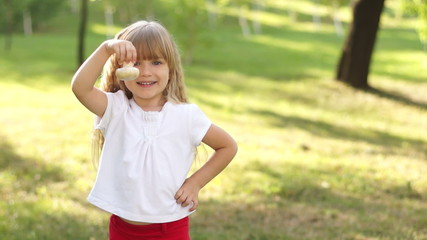 Child holding a mushroom