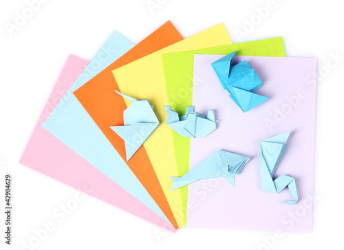 blue origami on bright paper, isolated on white