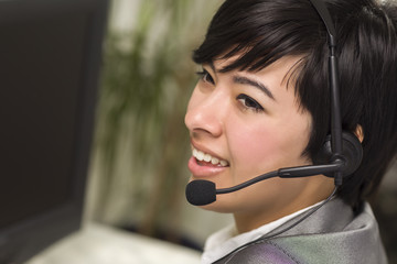Attractive Young Mixed Race Woman Smiles Wearing Headset