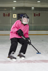 Ringette Skater in Action at Rink