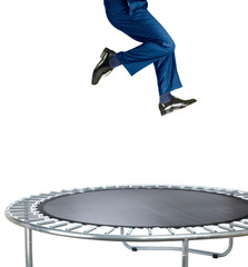 businessman bouncing on a trampoline on white