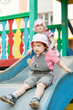two children on slide