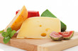 Colorful cheese variation on cutting board.