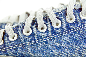 old jean canvas shoes  on the background
