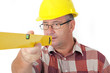 Construction worker looks at the spirit level