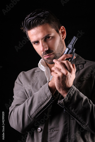 gangster or private detective with a pistol