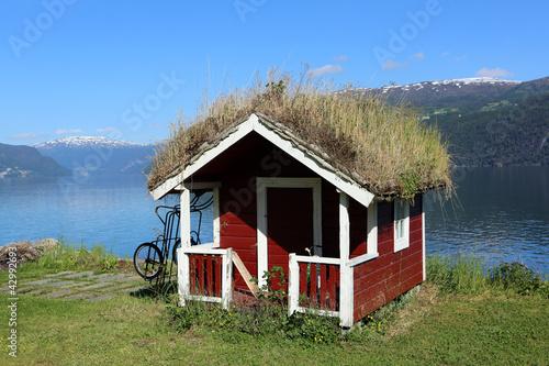 Leinwanddruck Bild Grass roofed Hut in Norway